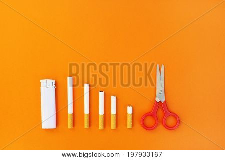 Quit smoking concept ,orange background top view