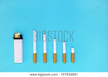 Quit smoking concept, cigarettes on blue background