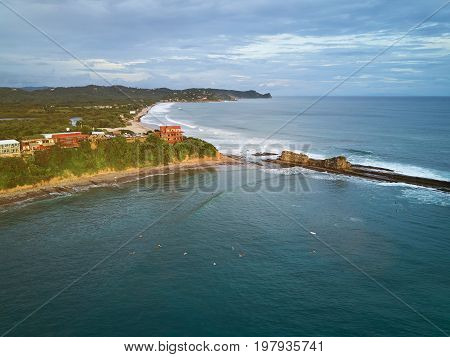 Surfing resort in Nicaragua aerial drone view. Magnific rock surfing spot