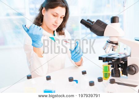 Young woman in microbiological laboratory