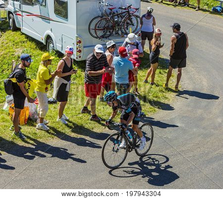 Col du Grand ColombierFrance - July 17 2016: The Colombian cyclist Sergio Henao of Team Sky riding on the road to Col du Grand Colombier in Jura Mountains during the stage 15 of Tour de France 2016.