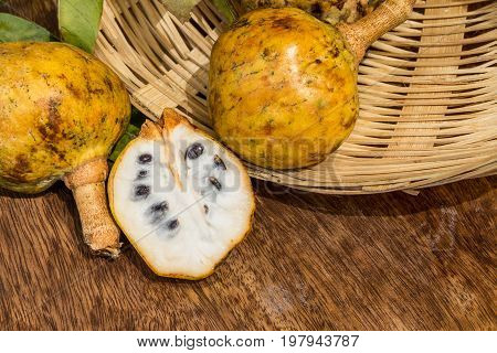 Annona scaly sugar apple fruit. Divided half annona cherimola fruit. Organic custard apple sweetsop fruit.Organic fruit concept. Selective focus.