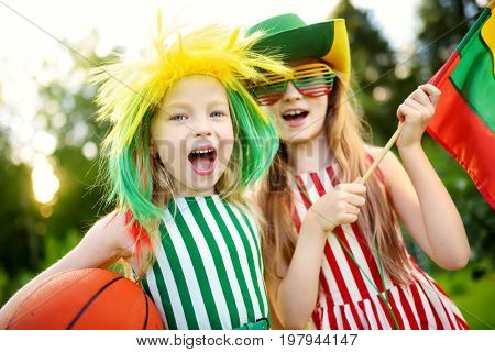 Two Funny Little Sisters Supporting And Cheering Their National Basketball Team During Basketball Ch