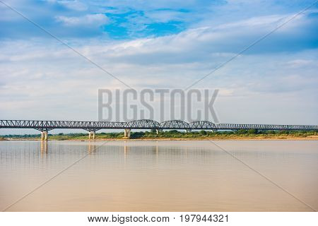 Steel Bridge Over The Irrawaddy River In Mandalay, Myanmar, Burma. Copy Space For Text.