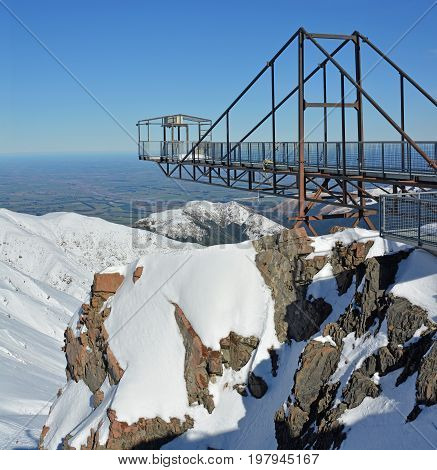 Vertical Panoramic View of Bunji Jump Tower at the Mount Hutt Ski Field in Canterbury New Zealand. The Canterbury Plains are in the background.