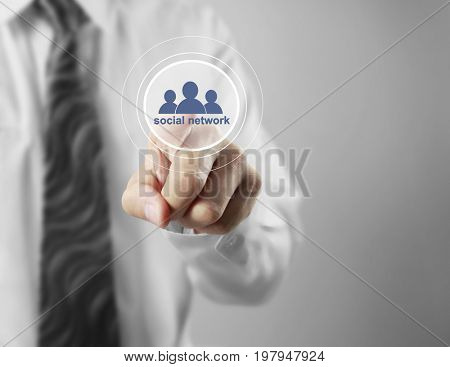Businessman touching graphic of social network virtual icon, business connection concept and successful partnership network concept on visual screen, green background, relationships in the digital age