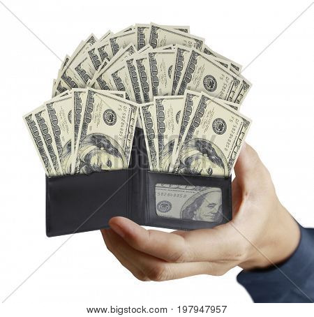 Hand holds the full purse and American dollars money from open black leather wallet, isolated on white