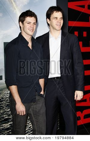 LOS ANGELES - MAR 8:  Steven R. McQueen and his stepfather Luc Robitaille arriving at the