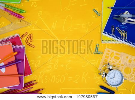back to school styed scene with school supplies on yellow with math formulas