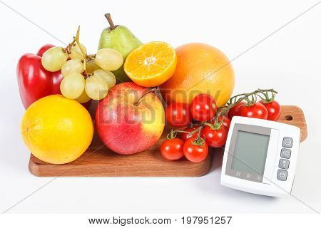 Blood Pressure Monitor And Fresh Fruits With Vegetables, Healthy Lifestyle Concept