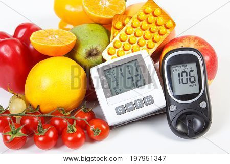 Glucose Meter, Blood Pressure Monitor, Fruits With Vegetables And Medical Pills