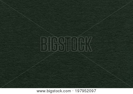 Texture of old dark green paper closeup. Structure of a dense cardboard. The background.