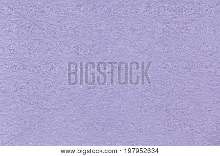 Texture of old light violet paper closeup. Structure of a dense cardboard. The lavender background.