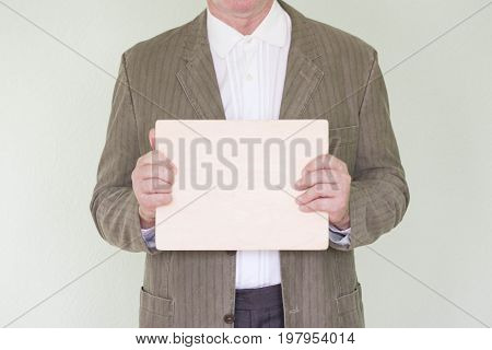 Business Concept Businessman. Holds An Empty