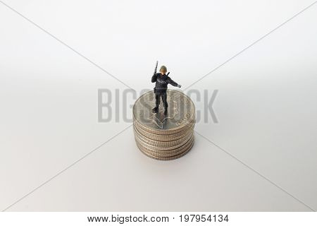 Min Of  Swat Figure Stand On Coins