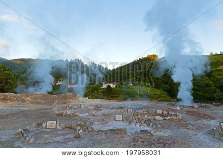 Geysers in the village of Furnas Sao Miguel Azores Portugal. Pools of naturally boiling water in village valley.