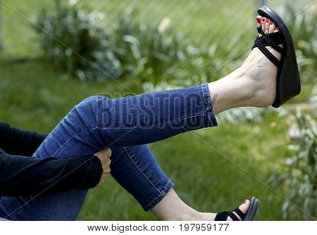 Woman's Hand Rubbing Her Foot