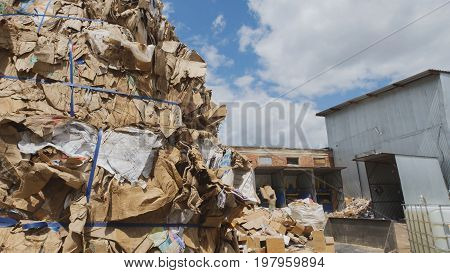 Heaps of cardboard at industrial landfill, ecology concept, wide angle