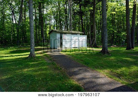 FIFE LAKE, MICHIGAN / UNITED STATES - MAY 27, 2017: The Michigan Department of Transportation Roadside Park, honoring J. Charles Brown, offers an outhouse facility on U.S. Highway 131.