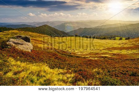 Huge Boulders On The Edge Of Hillside At Sunset