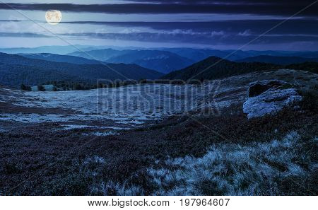 Huge Boulders On The Edge Of Hillside At Night