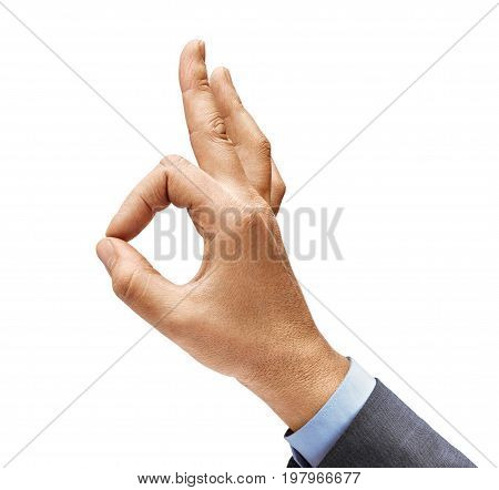 Man's hand in a suit shows gesture okay. Positive concept. Close up. High resolution product