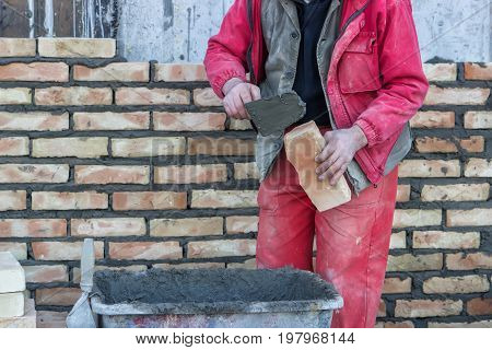Mason Hand Spread A Mortar On Brick