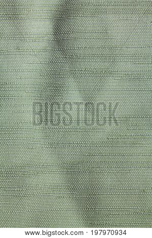 Texture Of Green Fabric Made Of Polyester
