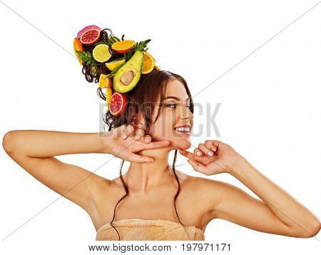 Hair and facial mask from fresh fruits for woman concept. Girl care her skin homemade by dint of organic therapy on isolated. Woman in profile is testing new diet. Opening of a new spa salon.