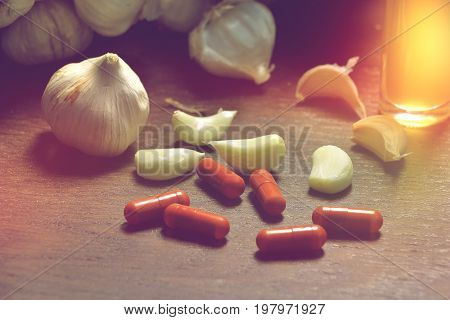 garlic garlic extract capsules and garlic oil alternative medicine or dietary supplements.