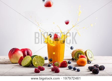 Nectarine juice splash. Various fruits on white table