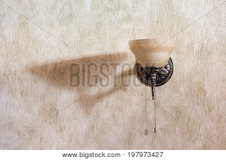 sconces placed on the wall with Venetian plaster