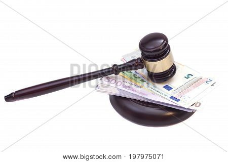 Judge wooden gavel and euro banknotes .