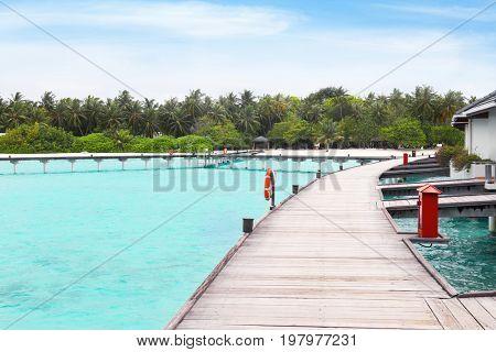 Wooden pontoon bridge at tropical resort