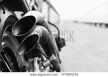 Double Exhaust Pipe And Wheel Of Motorcycle Close-up On The Back