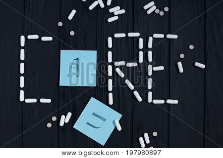 Table With Tablets, Pill Capsules And Color Cards In Shape Of Ca