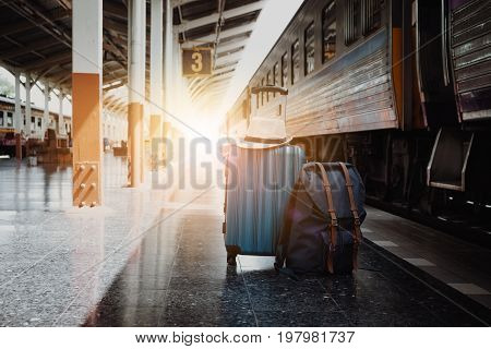Suitcases and backpack in train station summer vacation concept traveler suitcases