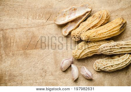 Peanuts or groundnuts on wooden ready to eating
