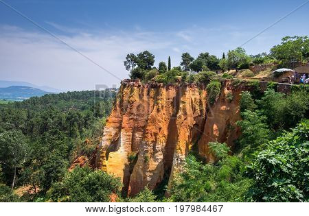 Red Ocher Cliffs Around Village Of Roussillon, Provence, France