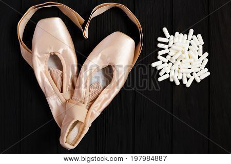 Ballet Shoes With Ribbons In Shape Of Heart And Pill Capsules