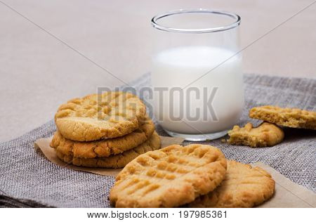 Healthy Peanut Butter Cookies And Glass Of Milk. Linen Napkin Background