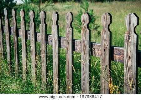 Woden fence made of oak wood outside a garden