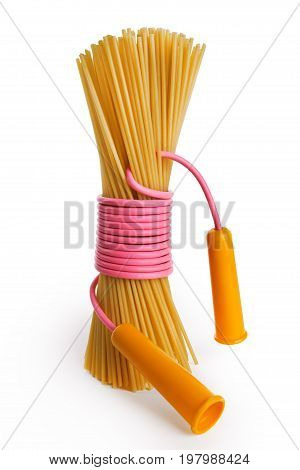 Dry pasta, standing upright, tied with pink rope