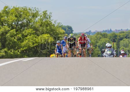 Mailleroncourt-Saint-Pancras France - July 5 2017: The breakaway approaching on a road to La Planche des Belle Filles during the stage 5 of Tour de France 2017.