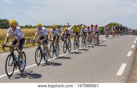 Mailleroncourt-Saint-Pancras France - July 5 2017: Team Sky with Geraint Thomas in Yellow Jersey riding in the peloton on a road to La Planche des Belle Filles during the stage 5 of Tour de France 2017.