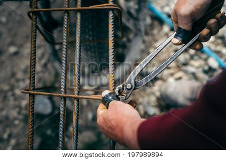 Details Of Construction Worker - Hands Securing Steel Bars With Wire Rod For Reinforcement Of Concre