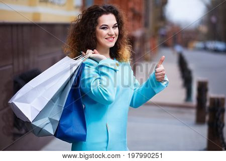 Happy Smiling Attractive Young Woman Holding Paper Shopping Bags