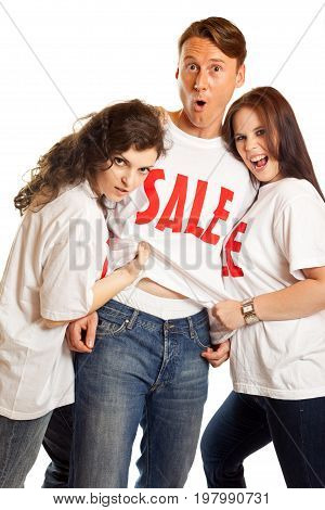 these girls are going wild over this sale event, tearing off the poor man's shirt