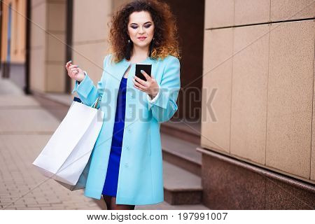 Happy Smiling Attractive Young Woman With Shopping Bags Looking