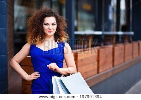 Happy Smiling Attractive Young Woman With Paper Shopping Bags Ne